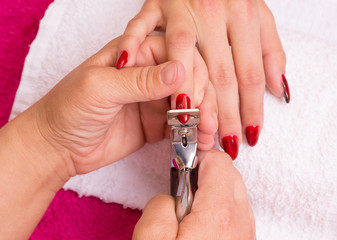 Woman receiving manicure in a  Spa,