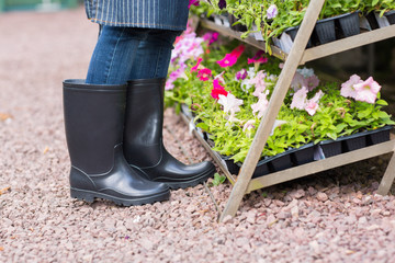gardener wearing gumboots in nursery