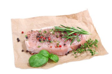 Raw meat steak with spices  herbs, isolated on white