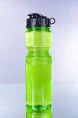 Sports bottle on grey background