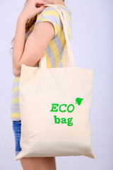 Woman with eco bag, isolated on white