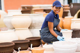Fototapety african female hardware store worker