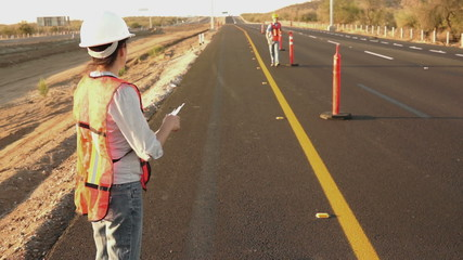 Road Worker Foreman Calling Laborer