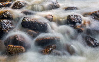 Water and rock  in the river natural motion blur abstract