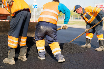 Construction workers during asphalting road works