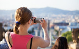 Young woman taking picture of Plaça Espanya, Barcelona, Spain poster