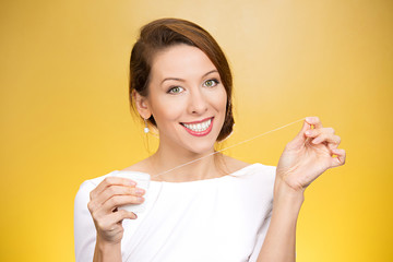 Female doctor dentist suggesting to floss daily