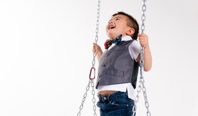 Happy Young Boy Plays Swing Suspended Moving Laughing Child Play