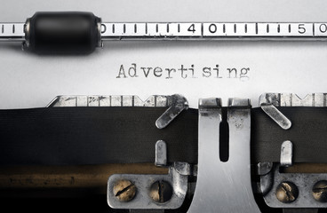 """Advertising"" written on an old typewriter"