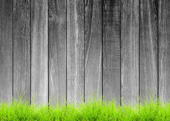 black and white rough wood plank with green grass foreground