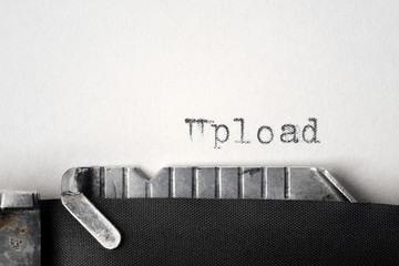 """Upload"" written on an old typewriter"