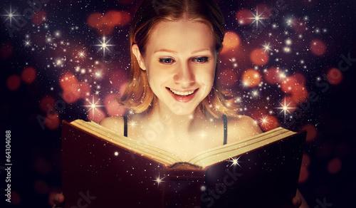 Leinwanddruck Bild girl reading  magic book