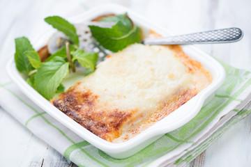Glass dish with vegetable lasagna, horizontal shot