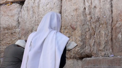 Jewish man pray at the western wall