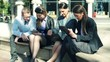 Group of young business people with tablet,laptop and smartphone