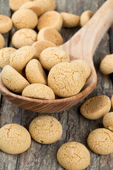 Traditional italian almond cookies - amaretti, on wooden surface