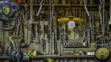 Vintage Tools Hanging On A Wall In A Tool Shed Or Workshop