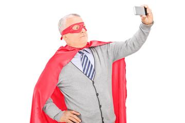 Masked mature man taking a selfie