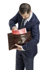 businessman gets documents from the portfolio