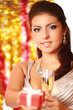 Young beautiful woman with champagne glass and gift.