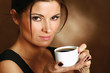 Portrait of a woman drinking coffee.