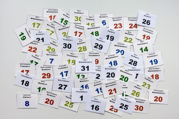 Calendar cards with week days and months, from above.
