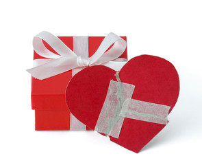 Gift box with heart, isolated on white background.