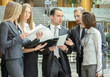 business people standing in the office with business plan