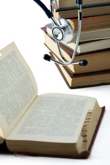 Concept of medical education with book and stethoscope.