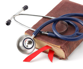 stethoscope on a book isolated on white background.