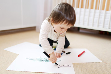 baby paints with black pens