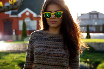 Portrait of a beautiful woman in fashionable sunglasses