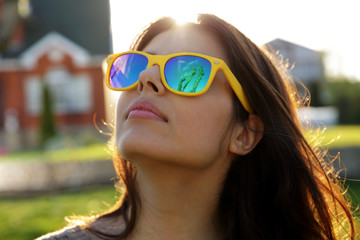 Closeup portrait of a beautiful woman in fashionable sunglasses