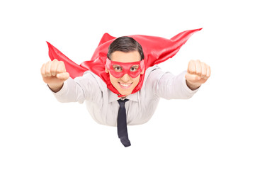 Superhero with red cape flying