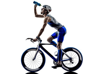 man triathlon iron man athlete cyclists bicycling drinking