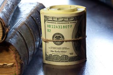 Rolled $100 dollar bills