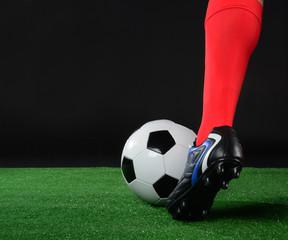 Balón y pie de jugador
