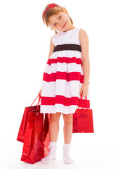 young girl goes shopping.