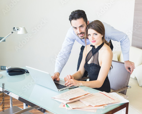 Business Couple Working at Office