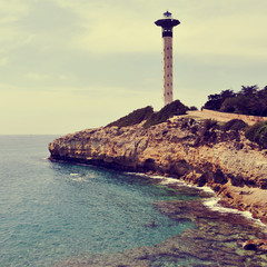 lighthouse in Torredembarra, Spain, with a retro effect