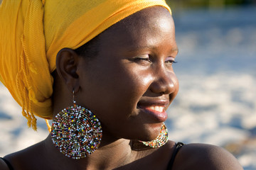 Beautiful african woman with scarf enjoying the sun