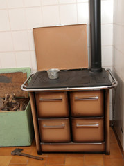 wood burning stove in a kitchen of a mountain home 3
