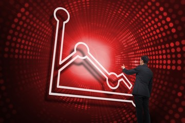 Composite image of graph and businessman pointing
