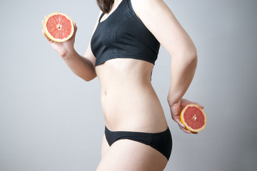 Female body with red grapefruit