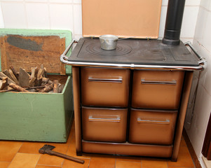 wood burning stove in a kitchen of a mountain home and the axe 2