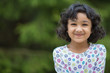 Outdoor Portrait of a Smiling Little Girl - 64324283