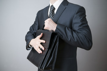 Businessman with briefcase in hand