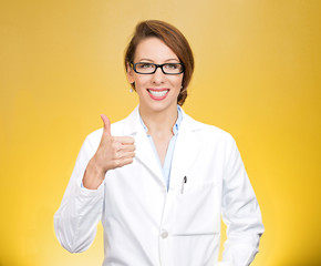 Healthcare professional with glasses giving thumbs up