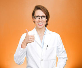 Female  healthcare professional giving showing thumbs up