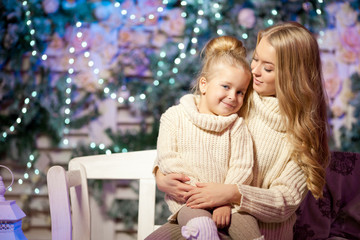 Winter mother and daughter. Smiling woman and child. Cute girl w